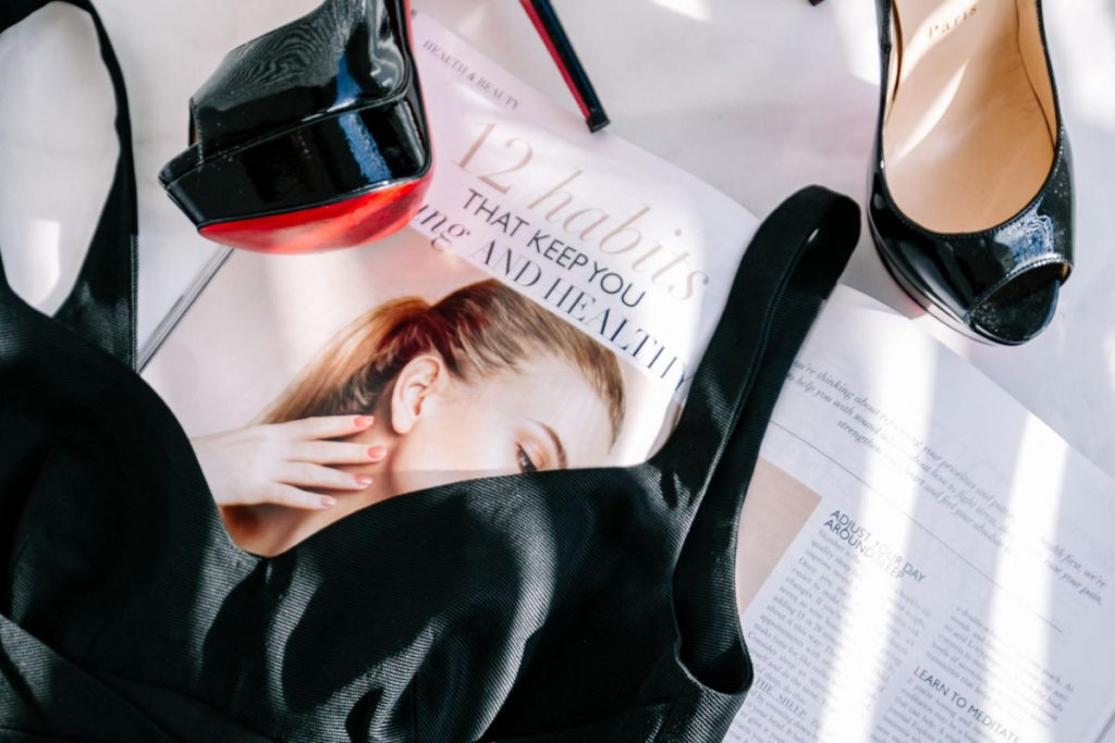 Ethical Brand Directory | Blog, Do Customers Who Buy Luxury Brands Care About Ethics + Sustainability? | Cover Image | Luxury Shoes and Fashion Magazine flatlay
