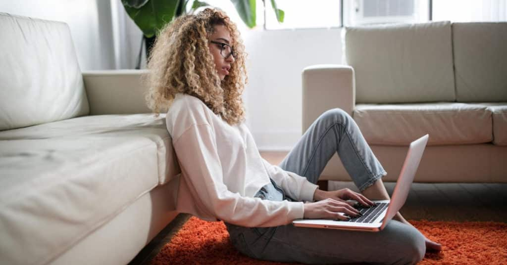 Ethical Brand Directory Blog | How do I know what brands I can trust? | Woman on laptop