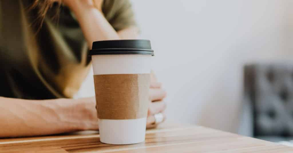 Ethical Brand Directory Blog | Top 10 Tips for Going Green | Woman with coffee cup