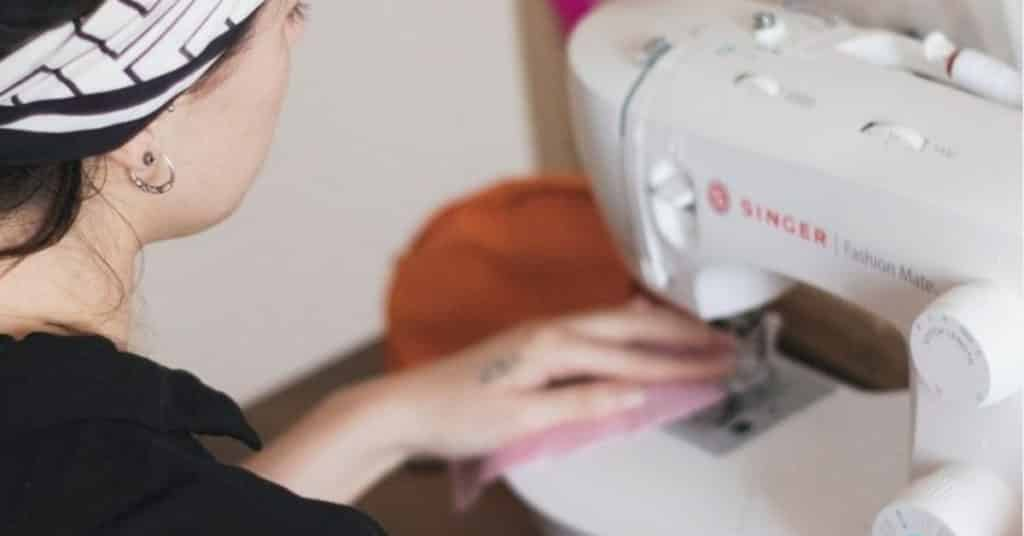 Ethical Brand Directory Blog | Top 10 Tips for Going Green | Woman with a sewing machine.