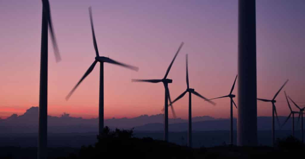 Ethical Brand Directory Blog | Top 10 Tips for Going Green | Wind Turbines in the sunset