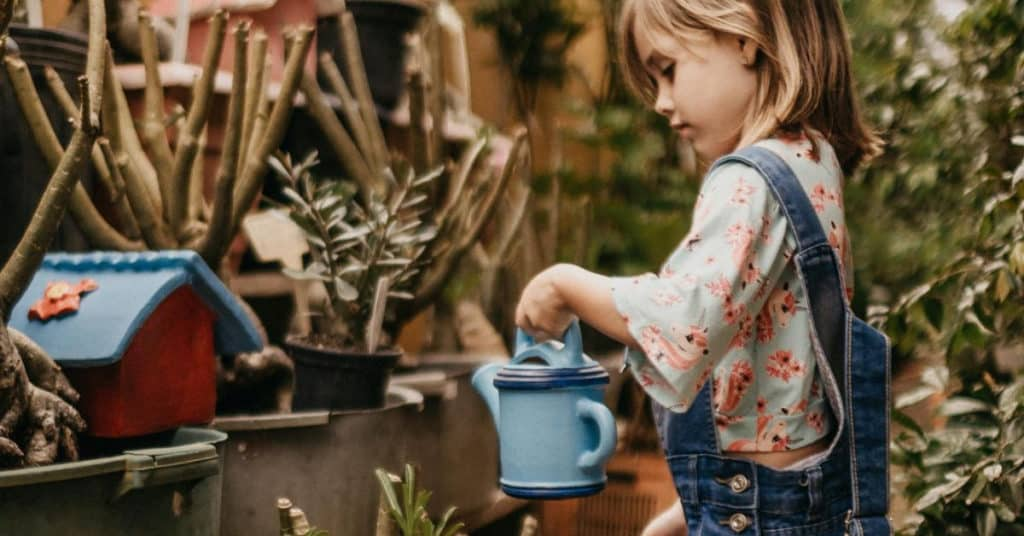 Ethical Brand Directory Blog | Top 10 Tips for Going Green | Little girl watering plants