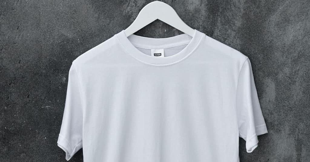 Ethical Brand Directory Blog   How is a white t-shirt made  What should a white t-shirt cost?   White T-shirt on hanger