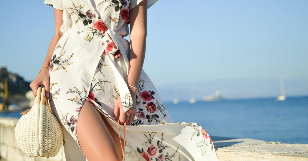Ethical Brand Directory Blog | Building A Sustainable Summer Wardrobe | Woman in maxi dress walking on beach
