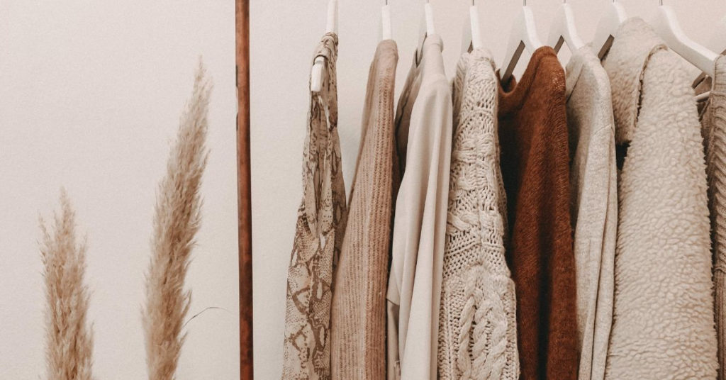 Ethical Brand Directory Blog | Building A Sustainable Summer Wardrobe | Clothing on a rack
