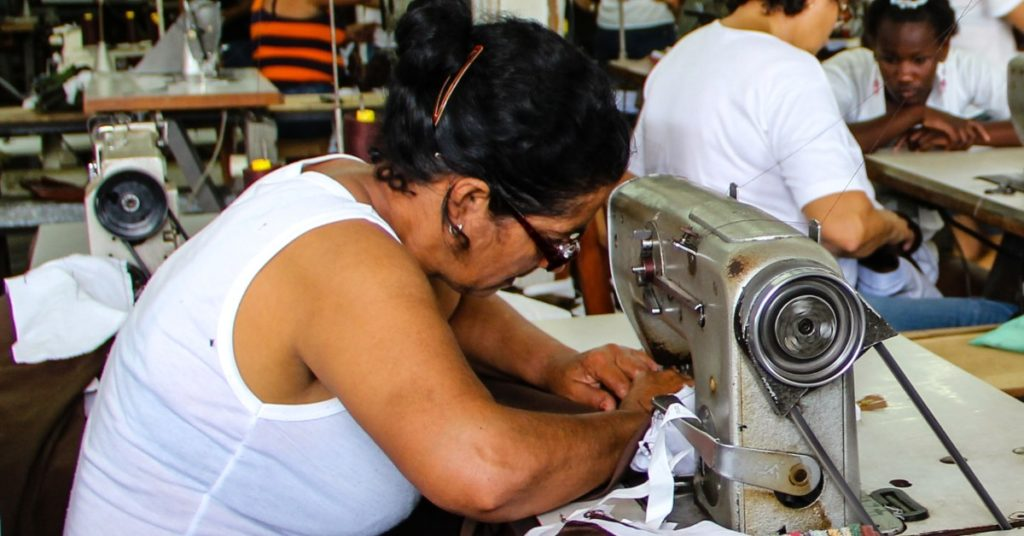 Ethical Brand Directory | BLOG | Why is an Ethical Fashion Business More Expensive To Run Than a Fast-Fashion One| Image: Woman working at a Sewing Machine
